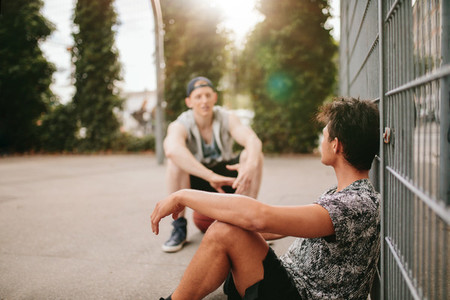 Streetball players taking break after a game