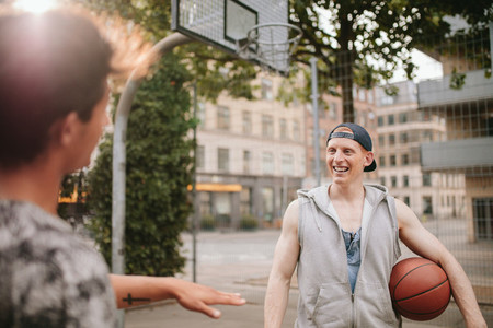 Happy young streetball players on court