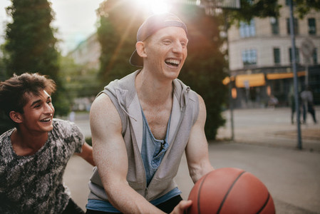 Friends playing basketball and having fun
