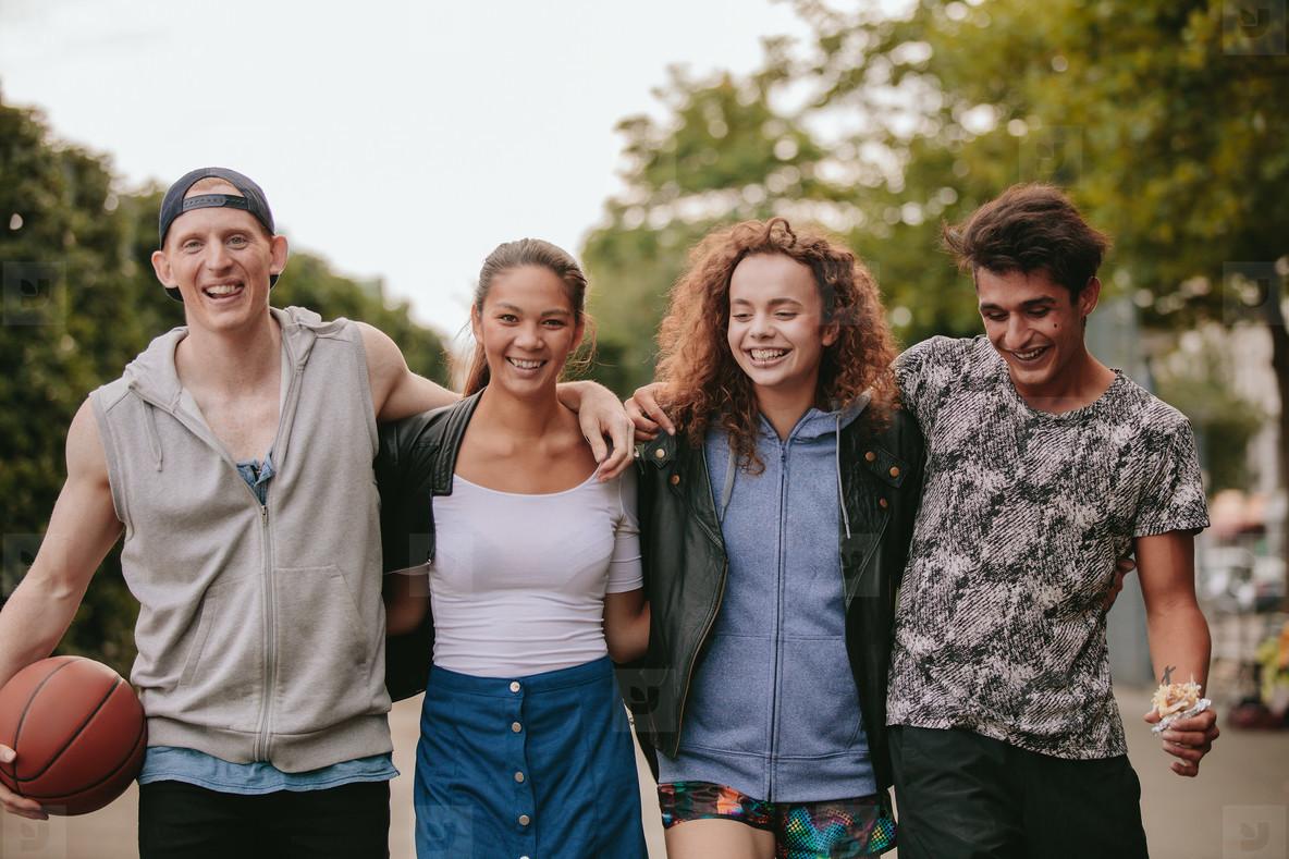 Multiracial group of people enjoying a walk outdoors