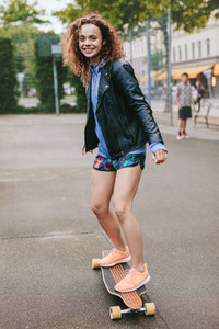 Teenage girl enjoying skating outdoors