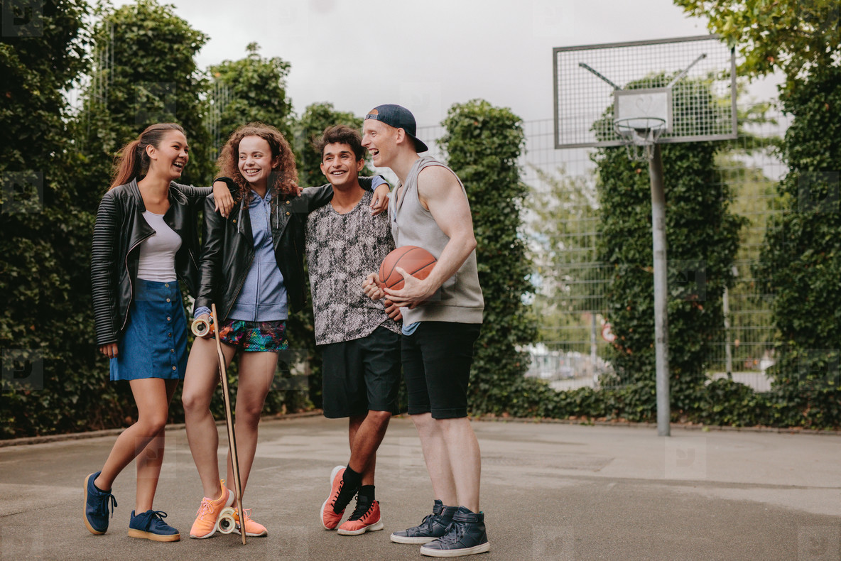 Multiracial group of people on basketball court