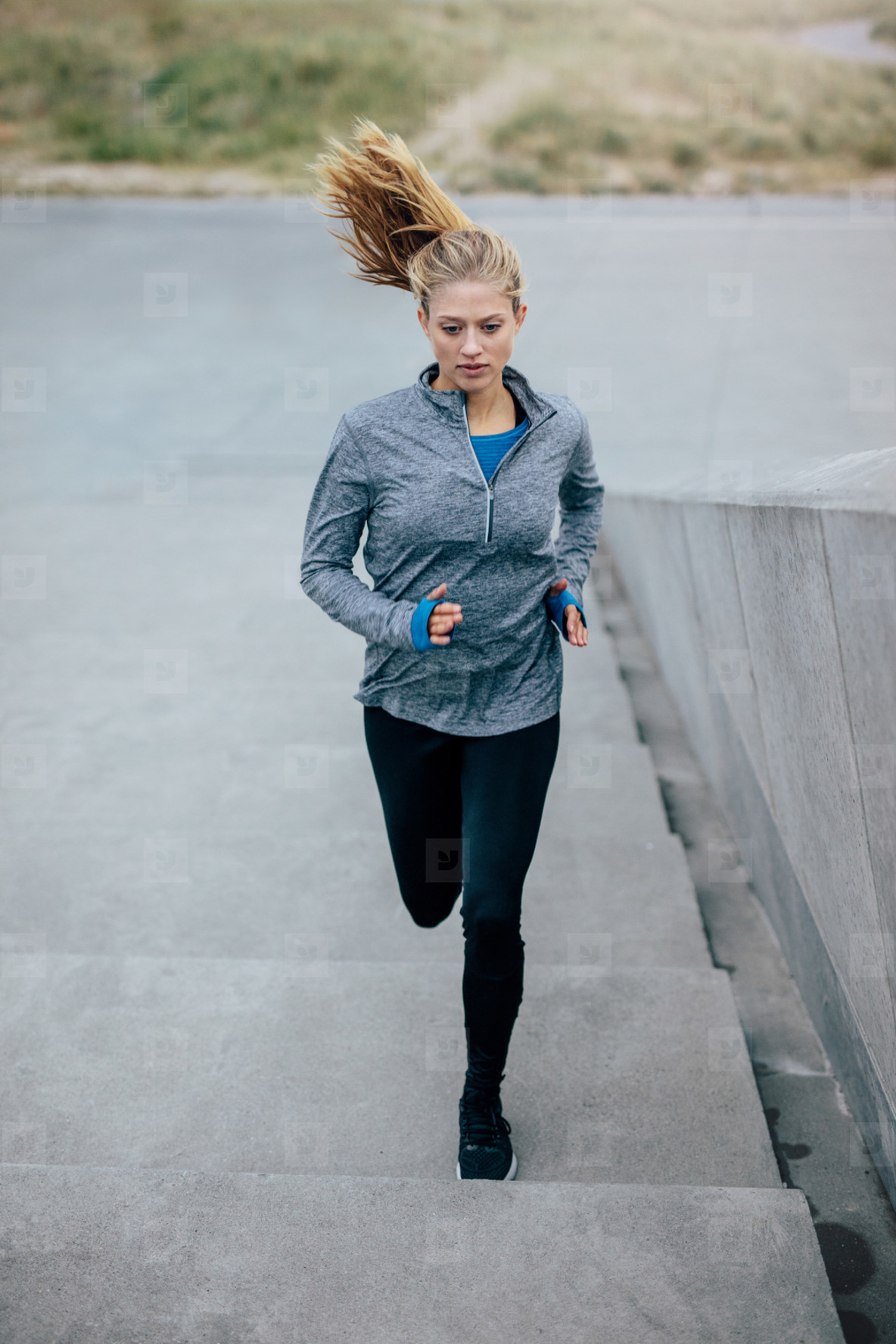 Fitness woman doing running exercise on stair