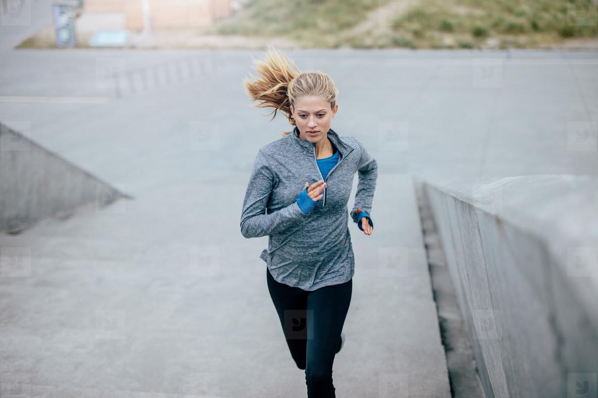 Fitness female exercising in morning