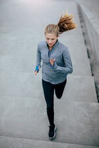 Fitness model doing running workout in morning