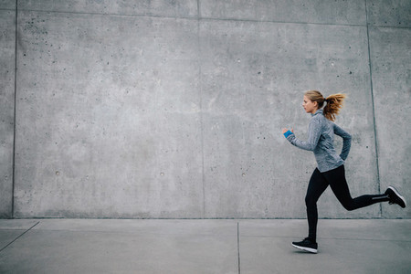 Healthy young woman running outdoors