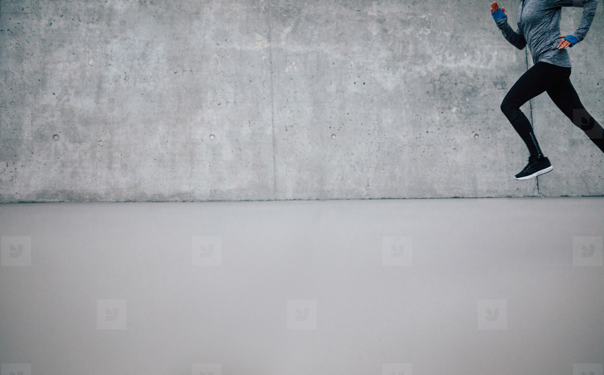 Athlete running on gray background