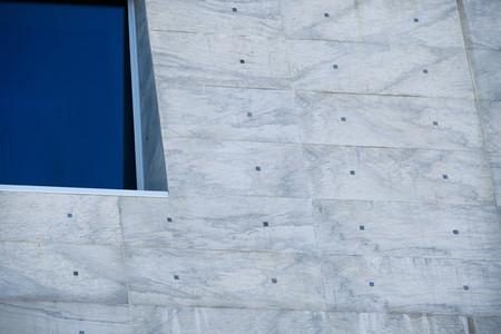 Blue window on a big gray facade