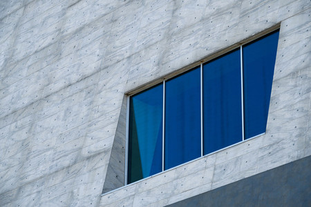 Blue window on a big gray facade