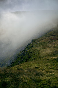 Fog rising up upon the hill