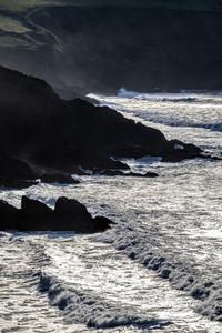 Big waves over cliffs