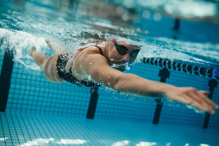 Female swimmer inside swimming pool