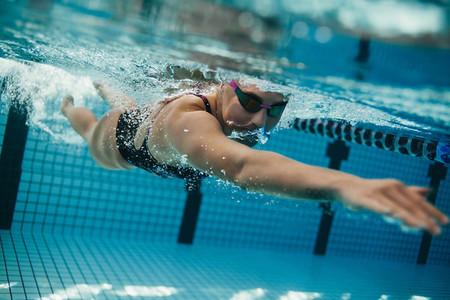 Female swimmer inside swimming pool
