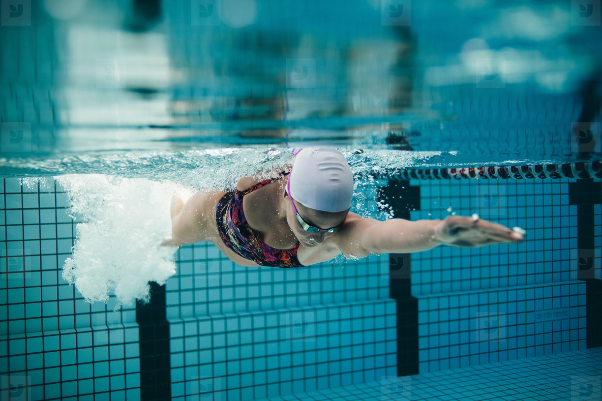 Female athlete swimming in pool