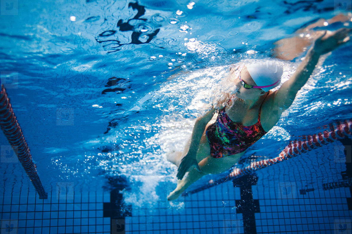 Underwater shot of swimmer training in the pool
