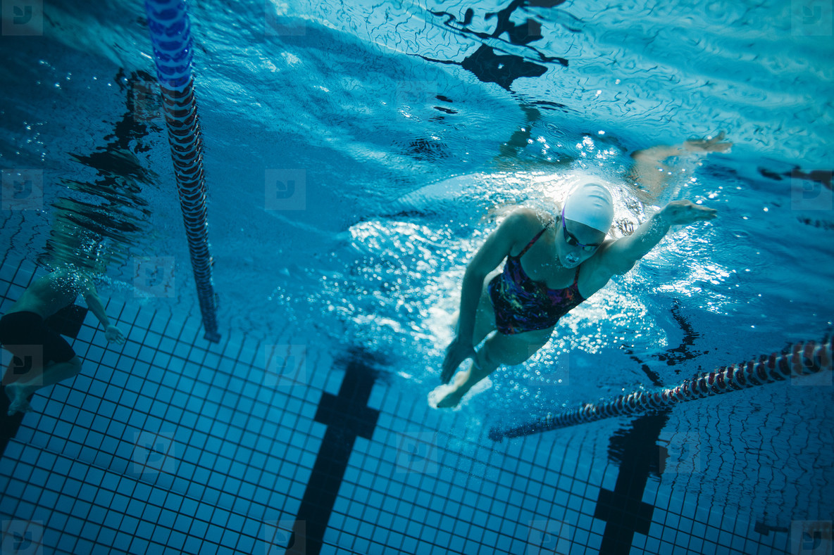 Photos - Young female swimmer training in the pool - YouWorkForThem