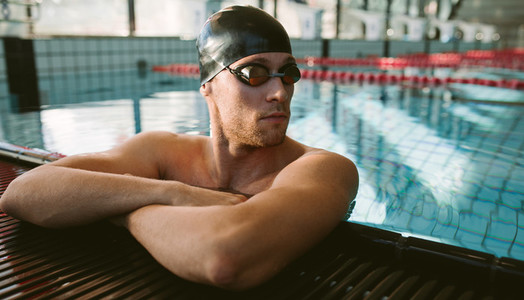 Professional male swimmer resting