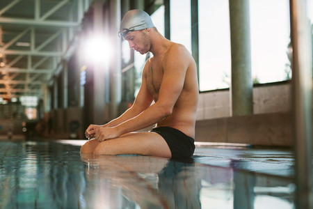 Male swimmer resting after a swim