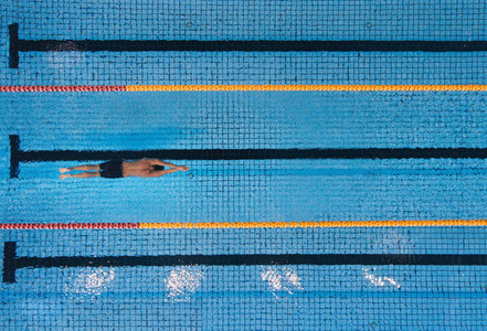 Male swimmer swimming laps in a pool
