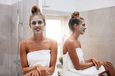 Beautiful young woman with facial mask