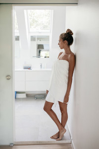 Young female after shower in bathroom