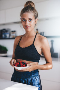 Woman having healthy breakfast in kitchen