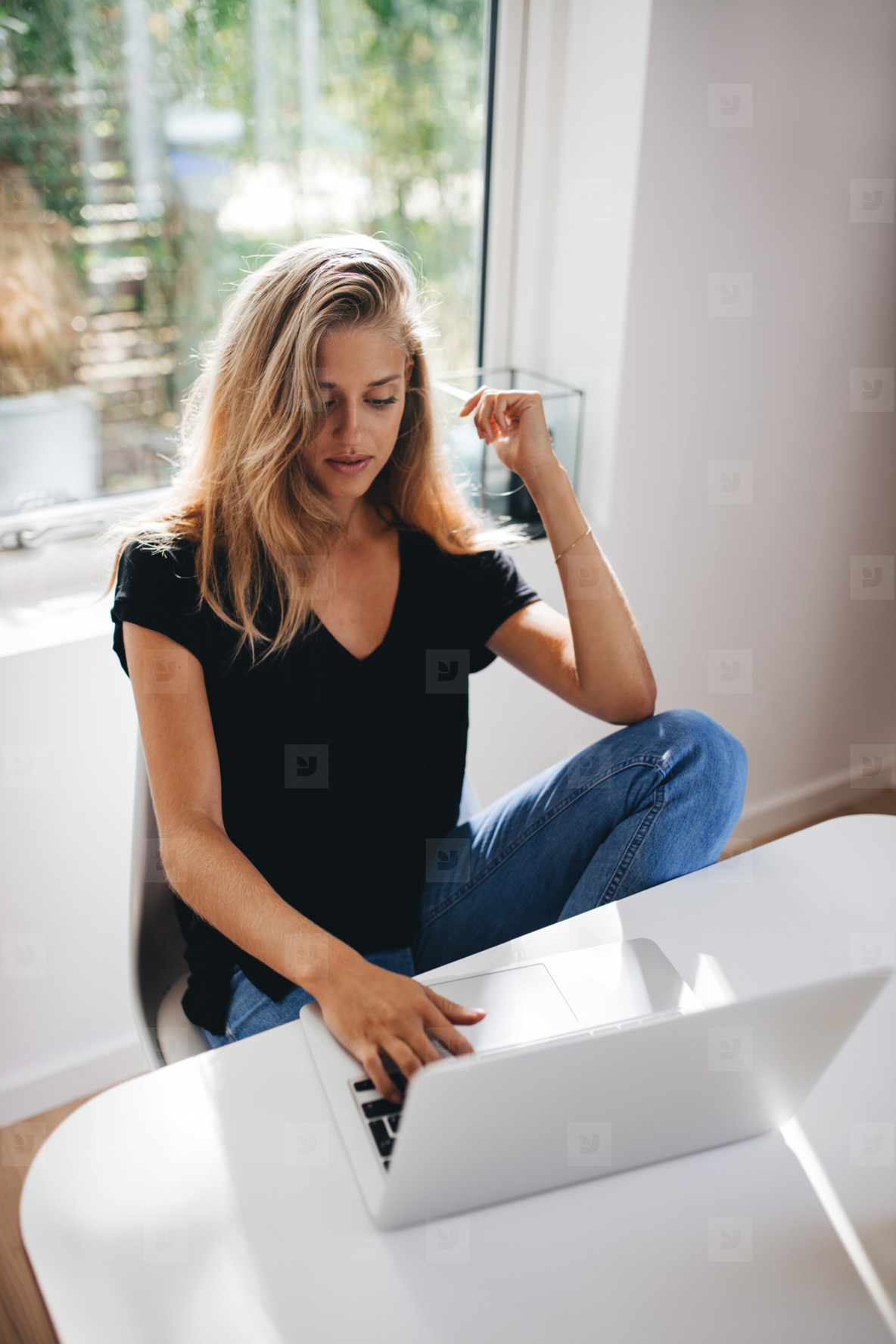 Female working on laptop at home