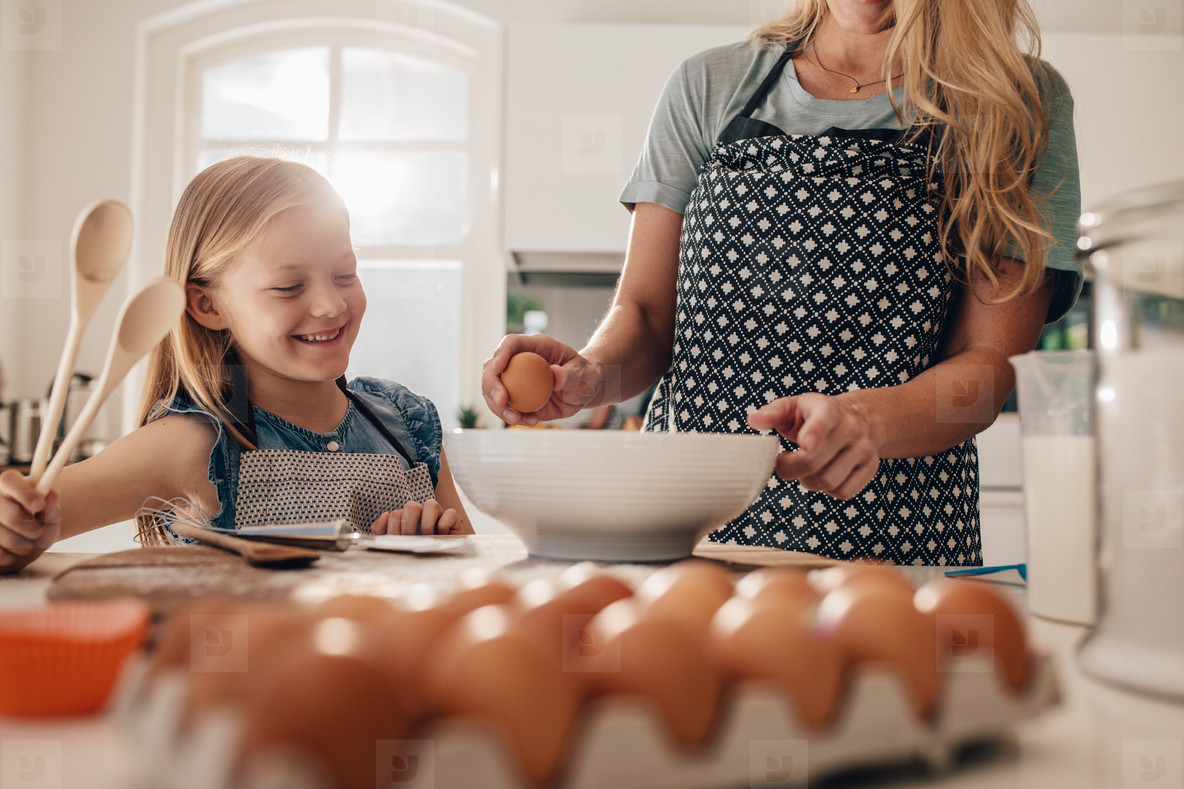 Mother and daughter cooking together in kitchen
