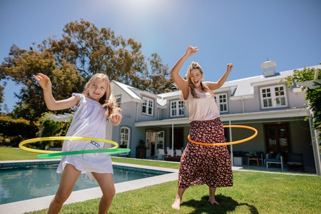 Young family playing with hula hoop