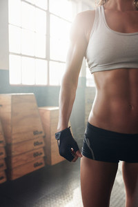 Female with perfect body standing at the gym