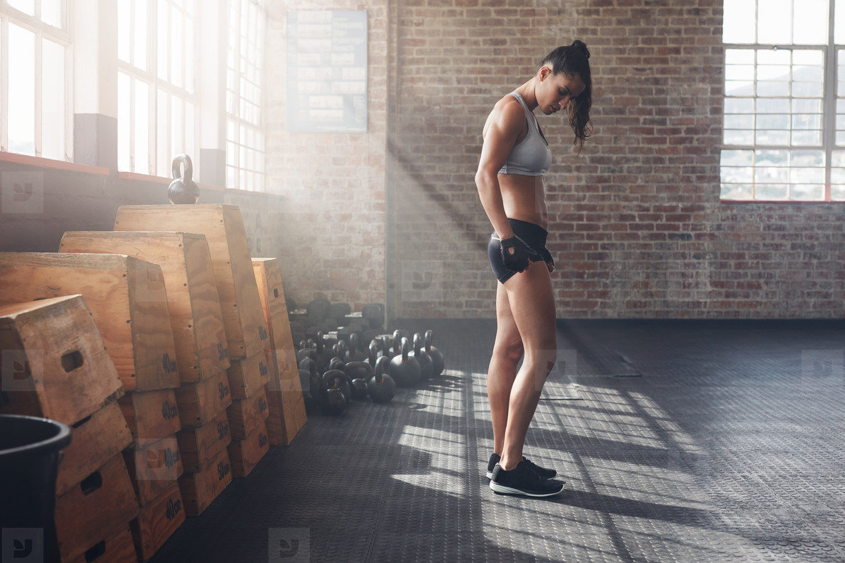 Determined young woman standing in gym
