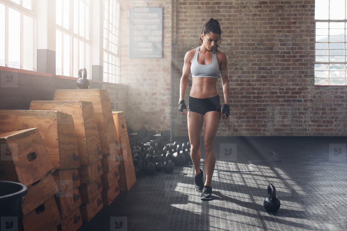 Fitness female getting ready for intense crossfit workout