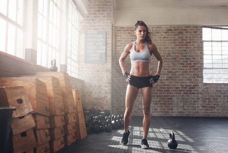 Determined fitness woman walking in the crossfit gym