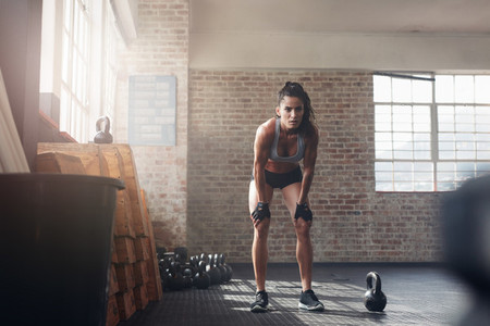 Woman looking focused about her fitness workout