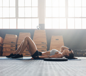 Fitness woman relaxing after exercise session