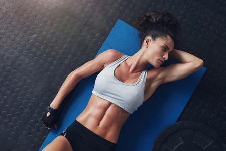 Fitness woman resting after physical training