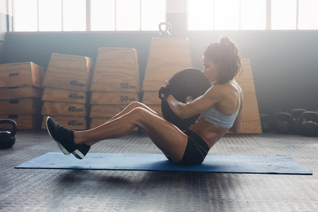 Energetic woman doing abdominal exercise