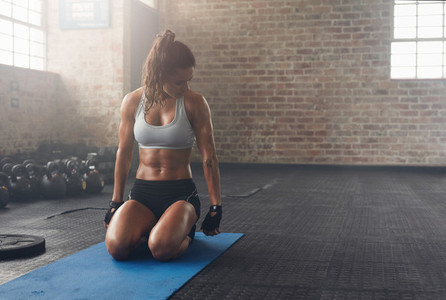 Muscular woman working out at the fitness club