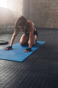 Female athlete exercising at gym