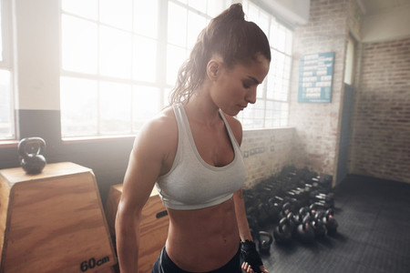 Healthy young woman standing in the gym