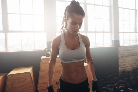 Fitness female standing in the gym