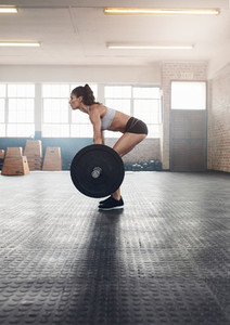 Fitness woman doing weightlifting exercise