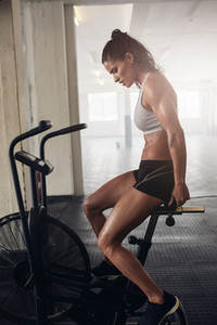 Muscular young woman doing intense cardio workout