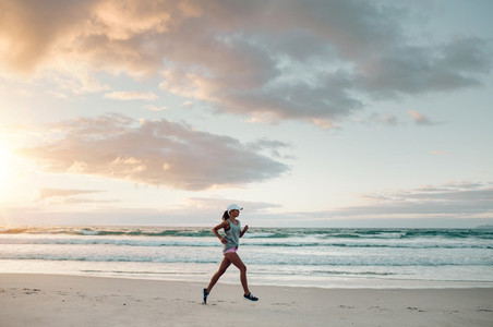 Fitness woman doing running exercise on the beach