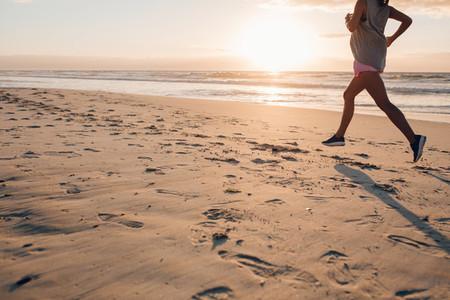 Female exercising on the beach