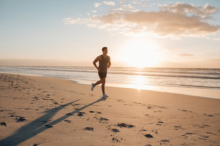Young man on morning run outdoors