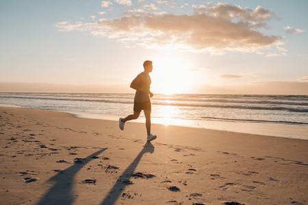 Runner running in morning along the beach