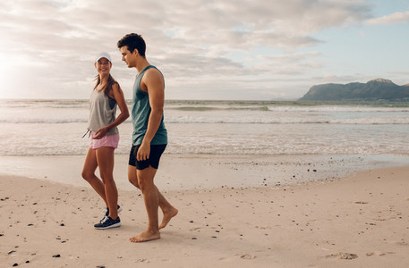 Young couple on walking along the shore