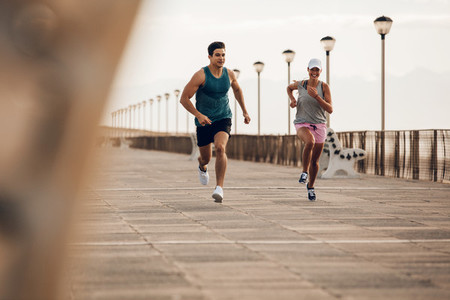 Couple of runners competing on promenade