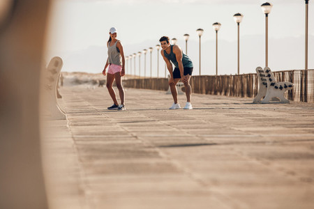 Young couple about to run on the promenade